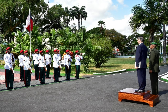 New Ambassador of Chile to Guyana, Mr. Patricio Becker Marshall takes the salute from members of the Guyana Defence Force at State House.