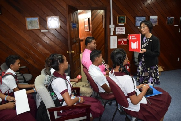 United Nations Resident Coordinator and United Nations Development Programme UNDP Country Representative Mikiko Tanaka interacting with Students of Three Miles Secondary.