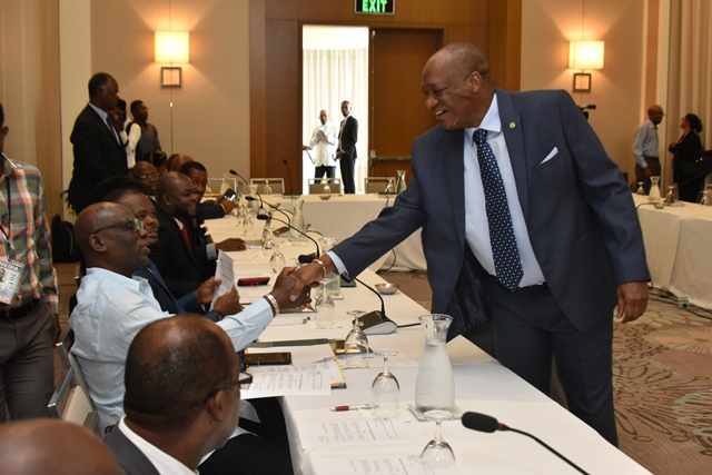 Minister of State, Mr. Joseph Harmon greets the participants of the Third Partnership Initiative for Sustainable Land Management (PILSM 3) High Level Meeting of Caribbean Ministers from Small Island Developing States (SIDs).
