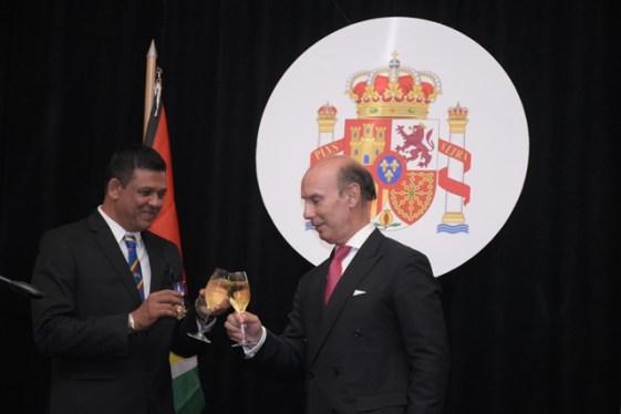 Spanish Honorary Consul Brian Tiwari (left) toasting with Spanish Ambassador to Guyana Javier Maria Carbajosa Sanchez (right).