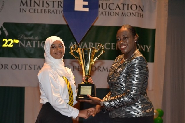 Aadilah Ali receiving one of her many awards for from Minister of Education Dr. Nicolette Henry.