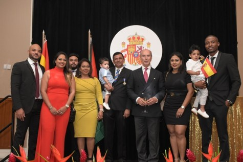 Spanish Honorary Consul Brian Tiwari (centre holding baby) with Spanish Ambassador to Guyana Javier Maria Carbajosa Sanchez, flanked by Tiwari family members.