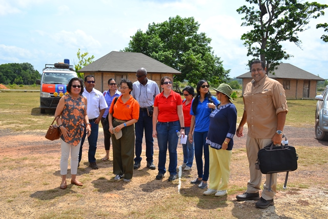 First Lady, Mrs. Sandra Granger (left) along with Canadian High Commissioner, Ms. Lilian Chatterjee (second right), UNDP Resident Representative to Guyana, Ms. Mikiko Tanaka (sixth right) and other partners arrive at the Bina Hill Institute today.