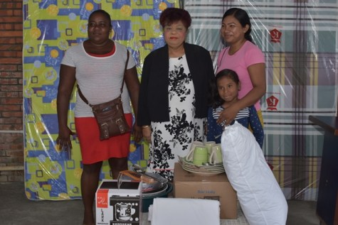 Minister of Social Protection, Ms. Amna Ally (center) with two victims of Sunday's fire.