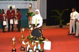Aadilah Ali with the awards she received for her outstanding performances.
