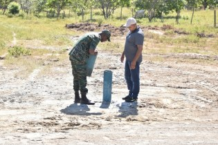 Director General of the Civil Defence Commission, Lieutenant Colonel Kester Craig and Vice Chairman of the Upper Takutu-Upper Essequibo Regional Democratic Council, Mr. Carl Singh, inspecting the well drilled at Aishalton Village.