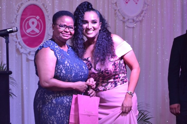 Minister of Public Health, Volda Lawrence, was recognised for being a cancer warrior at GTT's Pinktober dinner and gala.