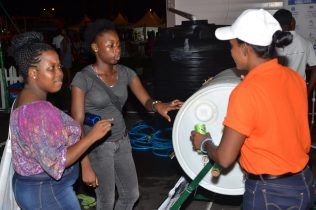 A Ministry representative demonstrating how composting is done