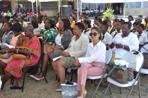 Teachers, education officers, students and parents at the commissioning of the 29th David 'G' School Bus ceremony.