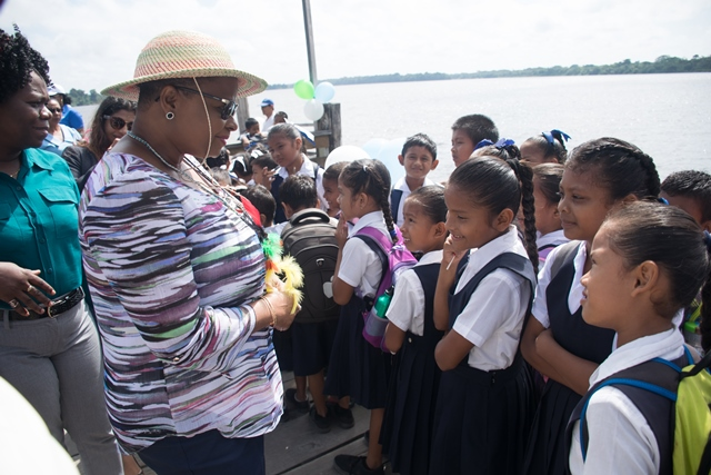 Public Health Minister more than one year after cancer, engaging students in Orealla.