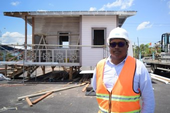 Engineer with the CHPA Randolph Hunte. CHPA's low-income model home [in background] will be part of the Ministry of Communities green communities display.