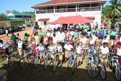 Director of Sport, Christopher Jones along with the students and their bicycles.