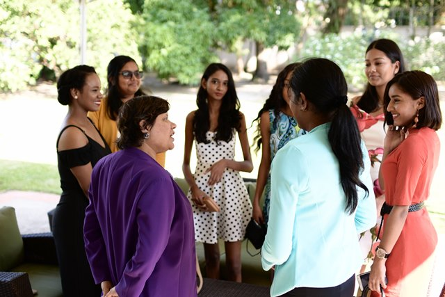 Canadian High Commissioner to Guyana, Lilian Chatterjee, interacting with the young girls.