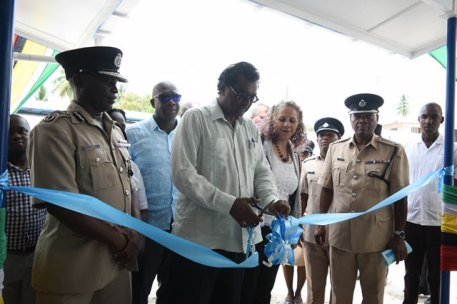 Minister of Public Security, Khemraj Ramjattan, flanked by Country Manager of the IDB, Sophie McKinnon and senior officials of the Guyana Police Force (GPF) and ranks of 'E' Division cut the ribbon to officially commission the Mackenzie Police Station.