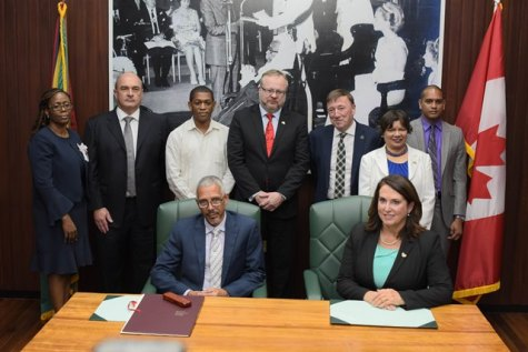 Minister of Business, Mr. Dominic Gaskin and Newfoundland and Labrador's Minister of Natural Resources, Ms. Siobhan Coady (both seated) flanked by Director, Department of Energy, Dr. Mark Bynoe (third left) and Canadian High Commissioner to Guyana Ms. Lilian Chatterjee (right) and other officials.
