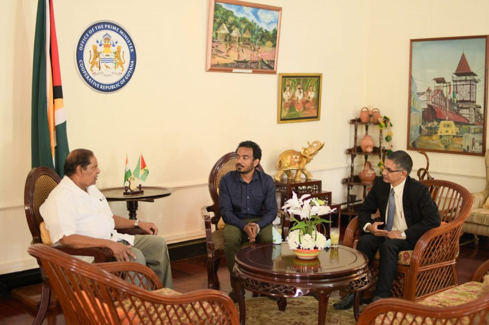From Left: Prime Minister Moses Nagamootoo engaging Indian sculptor Sameer Anil Sutar and Political Counsellor to the High Commissioner of India, R.K Perindia