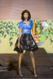 A model displays one of the outfits from the Eco Chic fashion show held at the Green Guyana Expo, that challenged young designers to be creative with plastic and pape