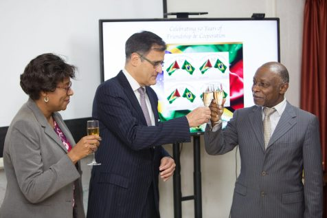 Minister Greenidge and Minister Hughes share a toast with Silos in celebration of 50 years of bilateral relations between Guyana and Brazil