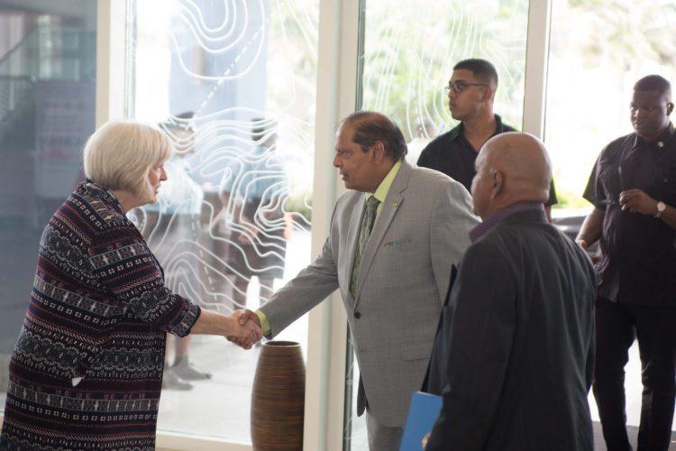 Prime Minister and Acting President, Moses Nagamootoo greets Chief Executive Officer, CAPAM, Gay Hamilton