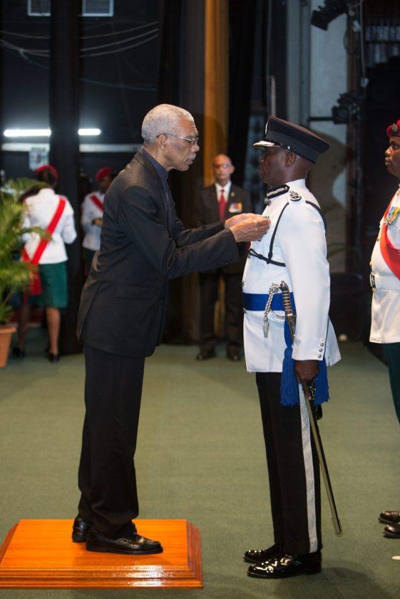 President David Granger conferring The Order of Service of Guyana, Disciplined Services Star on Commissioner of Police, Leslie James