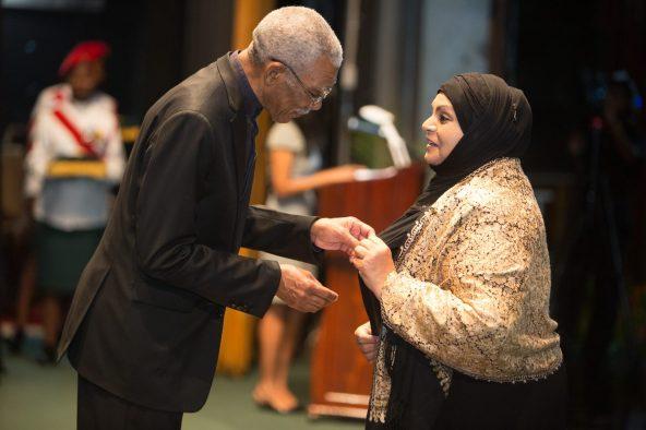 President David Granger conferring the Golden Arrow of Achievement on Head of the Women's Arm of the Central Islamic Organisation of Guyana (CIOG), Aleema Nasir