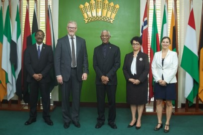 President David Granger is pictured with Norway's Ambassador, Nils Martin Gunneng, and Attorney General and Minister of Legal Affairs, Basil Williams SC., who is also performing the duties of Foreign Minister [left] and Director General of the Ministry of Foreign Affairs, Audrey Waddell [right].