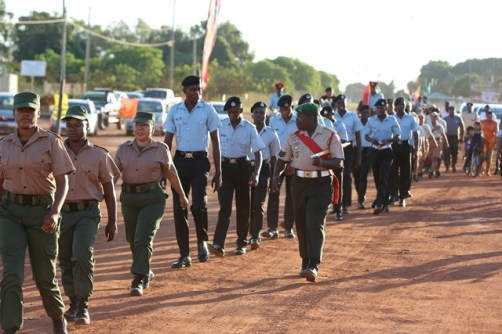 Disciplined Services marching during a parade to commence the week of activities.