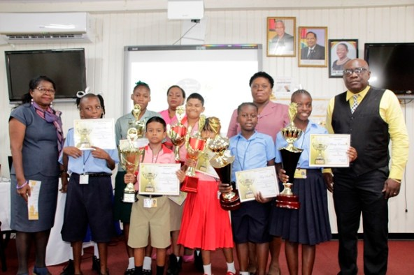 The winners of the 3rd Annual Signing Bee Competition displaying their winnings in the company of Senior Education Officers.
