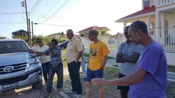 Minister of Agriculture, Noel Holder [third from left] alongside Minister of Business, Dominic Gaskin interacting with members of the Community Development Committee (CDC).