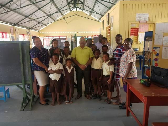 Regional Executive Officer (REO), Denis Jaikaran with school children and staff at Sand Hill.