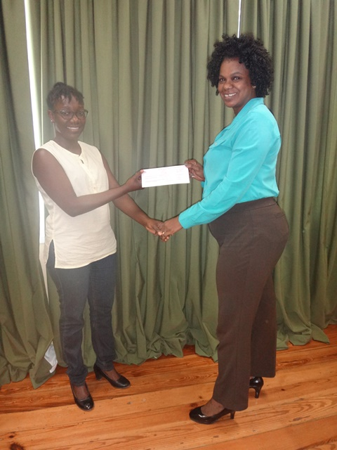Jewel Collier-Swan receiving her cheque from Leslyn Boyce, Assistant Director of Youth.
