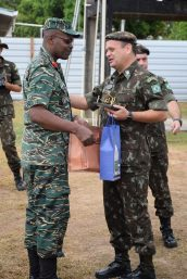 Commander, Engineering Corp, GDF, Colonel Gary Beaton presents Brigadier General, 2nd Engineering Group, Brazilian Army, Marcus Fontoura de Melo with tokens and a plaque for their support to the Guyana Defence Force.