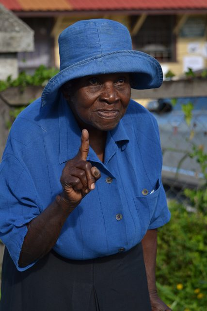 81-year-old Thelma Chupidore shows that she has voted.
