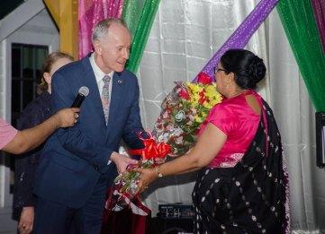 Russian Ambassador Alexander Kurmaz presenting Mrs. Sita Nagamootoo with a bouquet of flowers.