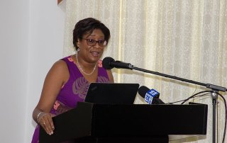 Minister of Public Telecommunications Catherine Hughes.