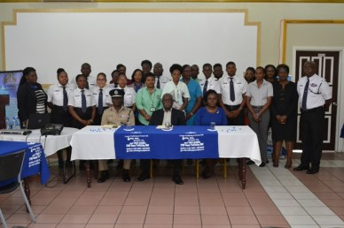 Seated at the front are Commissioner of Police, Leslie James, DSM, DSS, Minister of Citizenship, Winston Felix, and Coordinator of the Ministry of Social Protection's C-TIP Unit, Tanisha Williams-Corbin flanked by Immigration Officers and staff of the Department of Citizenship and Immigration.