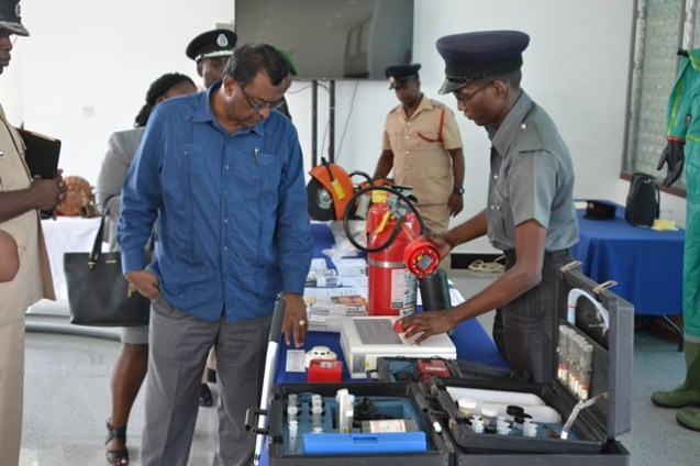 Minister of Public Security, Khemraj Ramjattan examines some of the equipment displayed at the Guyana Fire Service's stakeholder consultation held at the Arthur Chung Conference Centre (ACCC).