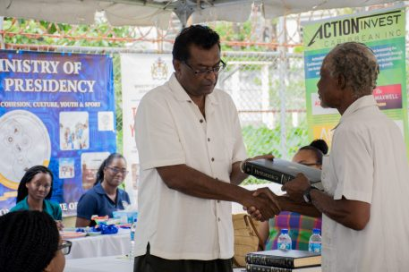 Minister Ramjattan hands over encyclopedias to community leader
