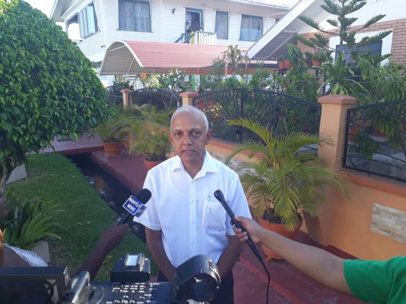Minister of Communities, Ronald Bulkan speaking to the media after casting his vote at LGE