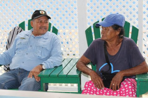 Minister of Indigenous Peoples' Affairs, Sydney Allicock engaging a resident of Canal Bank