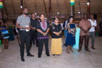 [In the photo, from left to right] Director of Sport, Christopher Jones and Prime Minister, Moses Nagamootoo along with his wife, Sita Nagamootoo enjoying the cultural show.
