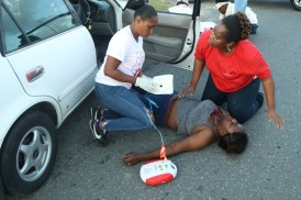 Enactment of a traffic accident and first aid demonstration by first responders.