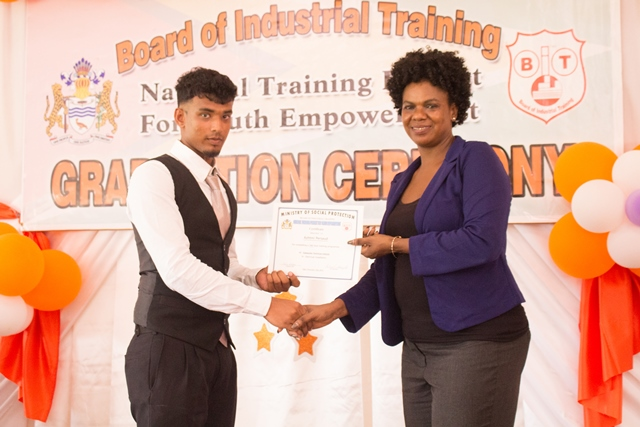 Graduates receiving their certificates from Assistant Director of Youth, Leslyn Boyce.