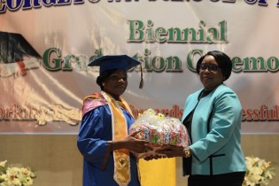 Valedictorian, Leola Charles receives her various awards.