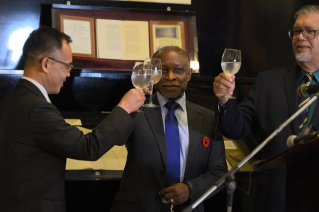 Minister Greenidge, Honorary Consul Ramesh Dookhoo and South Korea's Chargé d'affaires Dong-il Oh toast the opening of the Korean Consulate.