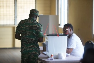 A GDF rank votes at the army headquarters, Camp Ayangana today.
