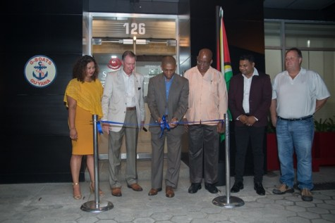 Director of the Department of Energy, Dr. Mark Bynoe [centre], Minister of Finance, Winston Jordan, President of the GCCI, Deodat Indar, Business Development Manager for Edison Chouest, Daniel LaFont, and others officially open G-Boats office in Guyana.