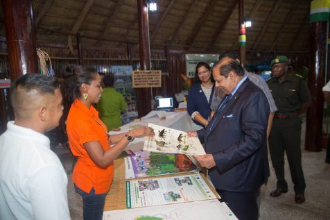 Prime Minister Nagamootoo interacting with an exhibitor