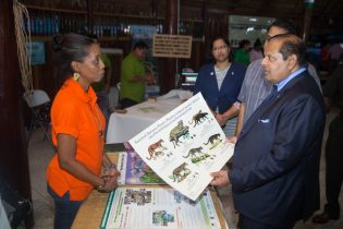 Prime Minister Moses Nagamootoo interacting with one of the exhibitors