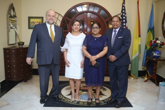 Prime Minister performing the duties of President, Moses Nagamootoo, and his wife pose with outgoing US Ambassador to Guyana Perry Holloway and his wife.